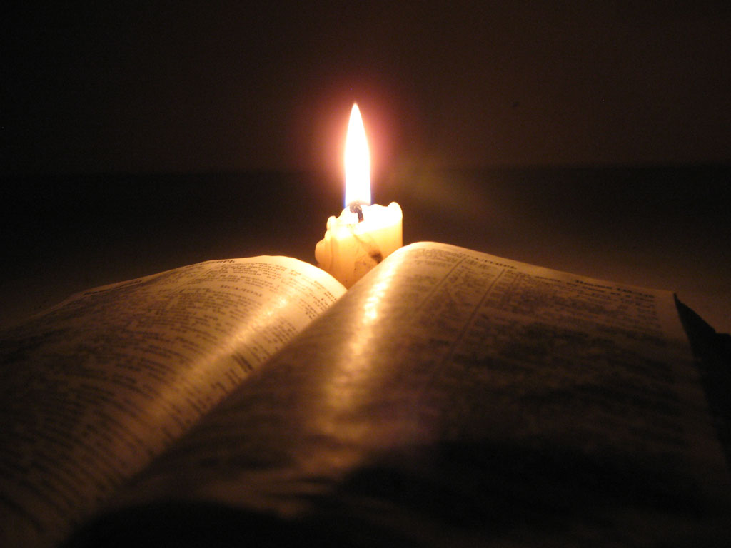 open bible with candle