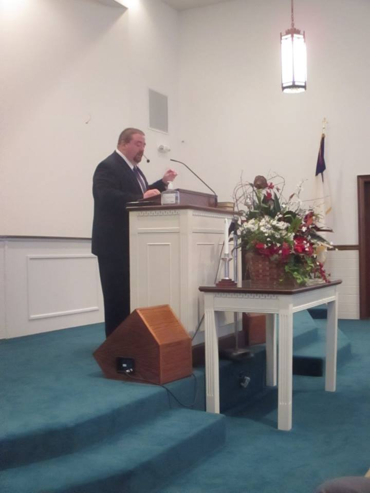 Pastor Brian preaching