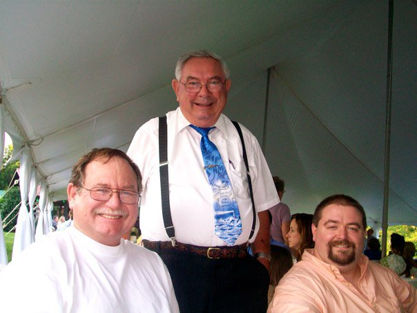 Dad (to the left), Grandpa, Rev. Odell Sisk (in the middle) and me (to the right)